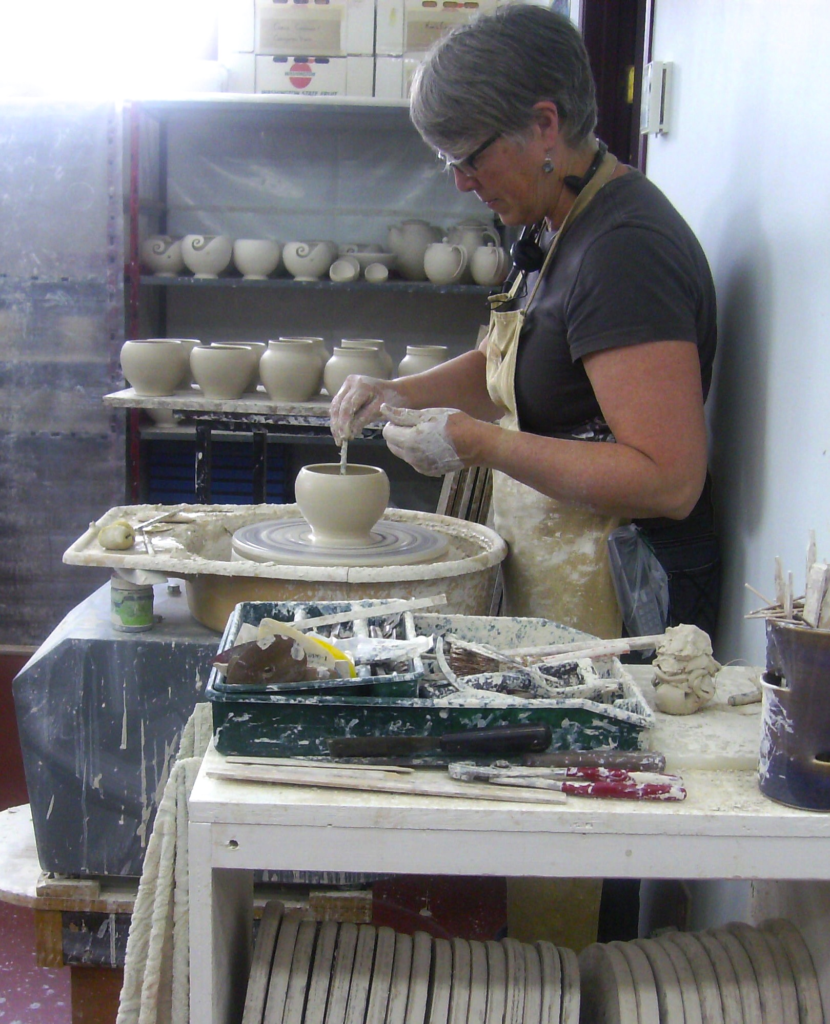 artist making pottery